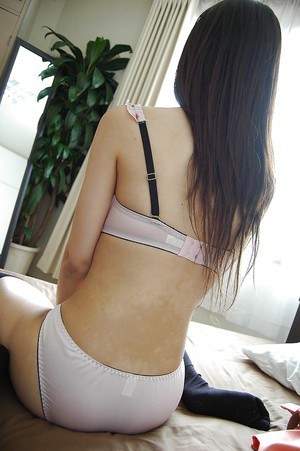 Smiley asian girl getting nude and exposing hairy gash in close up