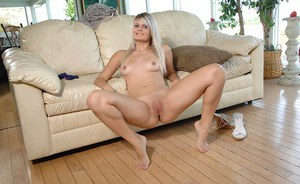 Foxy blonde stripping down and exposing her honey pot in close up