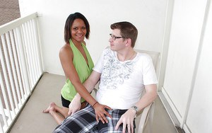 Sassy ebony chick reveals her nice tits and gives a handjob ob a white cock