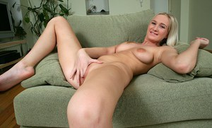 Smiley amateur blondie getting nude and fingering her soft pussy