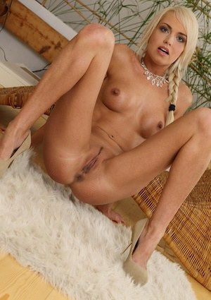 Frolic blonde with pigtails and shaved slit posing nude and teasing herself