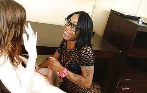 Tattooed ebony slut in glasses and sexy outfit stroking off a white cock
