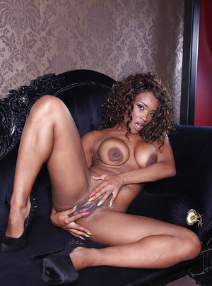 Curly-haired ebony MILF with ample booty undressing and spreading her legs