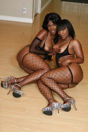 Bootylicious ebony lesbians in fishnets have some pussy licking and toying fun