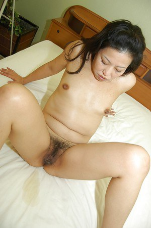 Slutty asian lady gives a blowjob and gets her hairy cunt cocked up