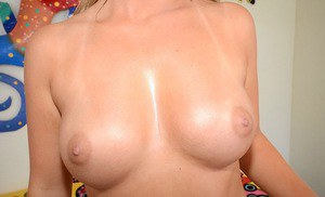Playful blonde coed getting nude and exposing her goods in close up