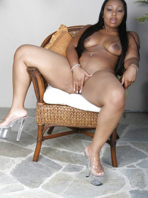 Chubby ebony girl in greyhound undressing and teasing her hungry pussy