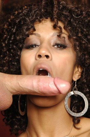 Curly-haired ebony vixen in nylons fucks a white boner for cum on her face