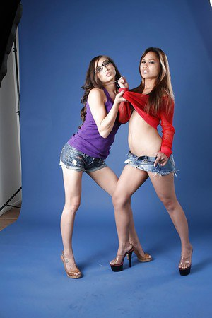 Naughty asian chicks in daisy duck shorts make some lesbian humping action