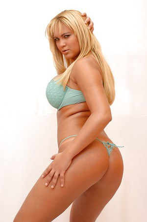 Frisky latina blondie taking off her lingerie and exposing her ample curves