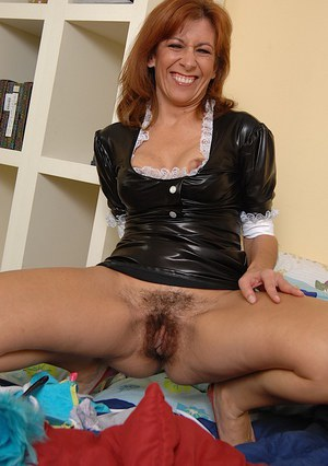 Sassy mature maid taking off her panties and exposing her bushy gash