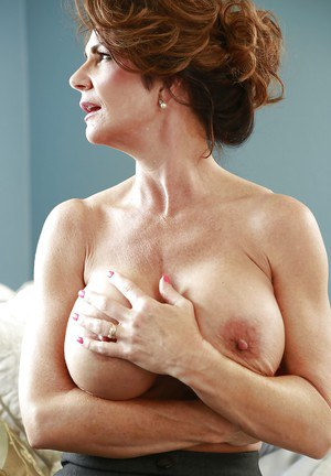 Mature bombshell with huge round jugs getting nude and spreading her legs