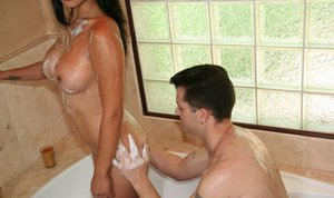 Stunning asian lady gives a soapy massage and a sensual handjob