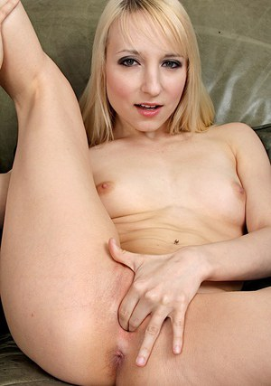 Tempting blonde amateur stripping down and fingering her pussy