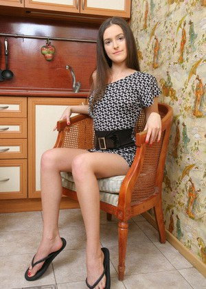 Amateur skinny teen spreading her long legs to tease her shaved slit