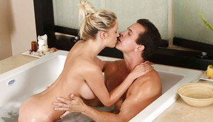 Busty blonde vixen gives an oily handjob and a wet nooky in the bathtube