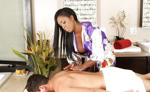 Slutty ebony masseuse has some 69 fun fith her client and jerks off his boner