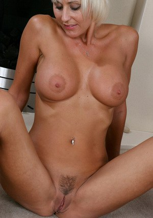 Big busted mature blonde stripping down and exposing her honey pot
