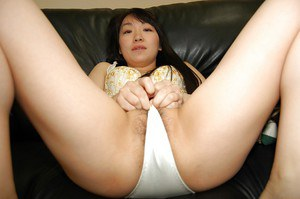 Shy asian MILF stripping down and exposing her hairy curves in close up