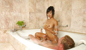 Sassy asian masseuse gives some wet handjob pleasure to her client