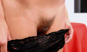 Naughty amateur undressing and exposing her trimmed honey pot