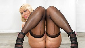 Curvy blonde MILF in stockings undressing and exposing her soaking cunt