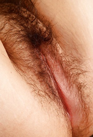 Chubby girl in glasses undressing and exposing her hairy gash in close up