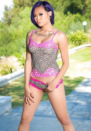 Tattooed asian hottie taking off her panties and fingering her slit outdoor