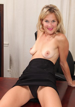 Sassy office blonde with saggy tits undressing and exposing her hairy gash