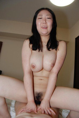 Slutty asian gal with ample melons gets her hairy pussy fingered and fucked