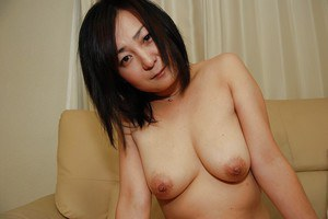 Lusty Japanese MILF strips down and has some pussy vibing fun