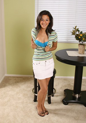 Smiley teenage amateur slowly uncovering her flawless graceful curves