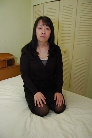 Fatty japanese MILF strips down and has some twat vibing fun