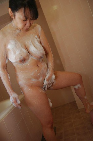 Chubby asian MILF with saggy tits takes shower and teases her hairy slit