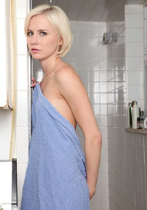 Skinny blonde amateur taking shower and teasing her shaved slit