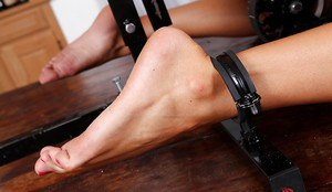 Kinky blondie with slippy curves has some fun with a BDSM sex machine