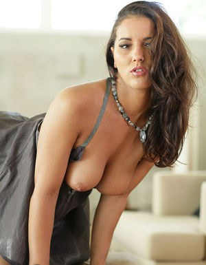 Perky brunette in sexy dress revealing her bosoms and inviting pussy
