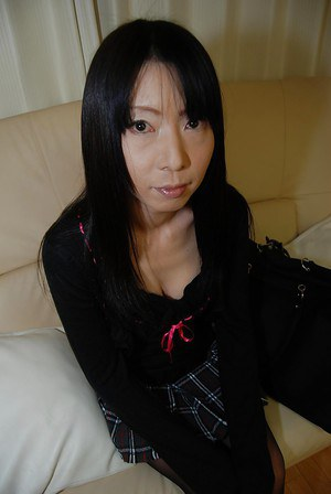 Busty japanese MILF with hairy cooter undressing and spreading her legs