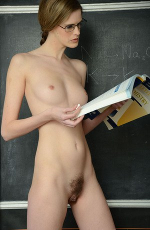 Skinny blonde bookworm in glasses getting nude in the classroom
