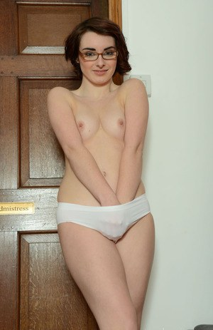 Frisky brunette chick in glasses showcasing her fuckable curves