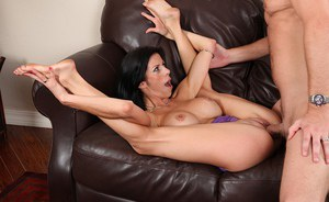 Well-stacked brunette MILF fucks and blows off a fat boner