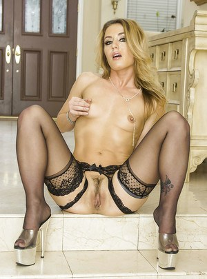 Foxy blonde in sexy stockings undressing and exposing her love holes