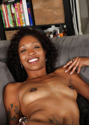 Lecherous ebony MILF getting nude and toying her soaking pussy