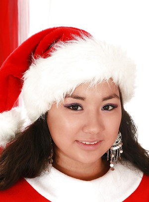 Lusty asian amateur taking off her X-mas outfit and exposing her slit