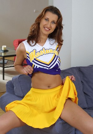 Graceful teen cheerleader with shaved slit undressing and spreading her legs