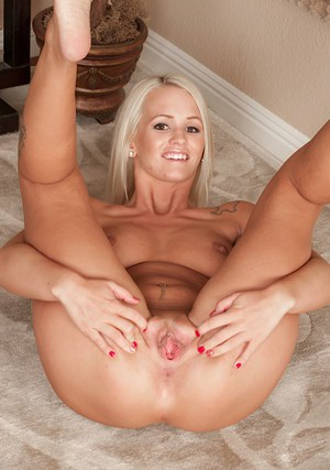 Wooing blonde with ample fanny taking off her panties and exposing her slit