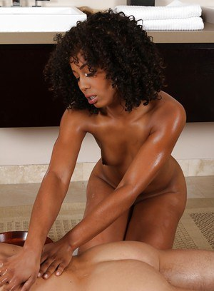 Curly-haired ebony vixen gives an oily massage ending up with cum on her belly