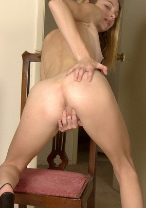 Skinny blonde amateur slipping off her clothes and playing with herself