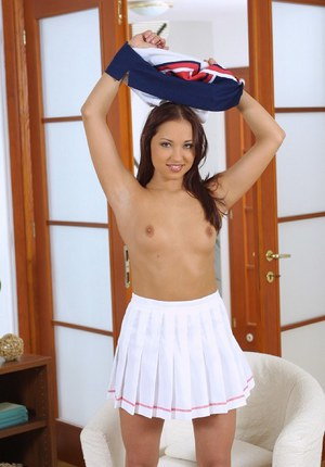 Smiley cheerleader with trimmed coter undressing and spreading her legs