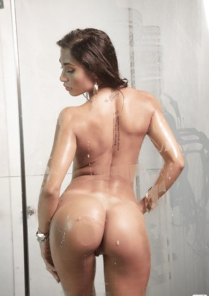 Steamy seductress with smoky eyes showcasing her curves in the shower